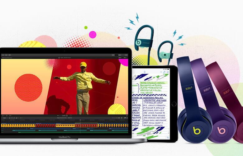 Um MacBook, um iPad e fones Beats sobrepostos, com manchas coloridas ao fundo